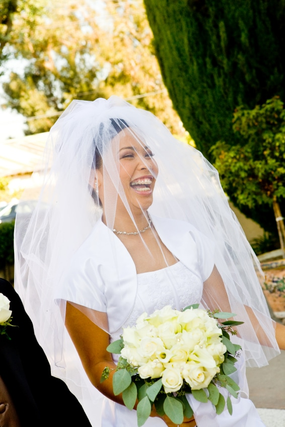 Smiling bride with braces