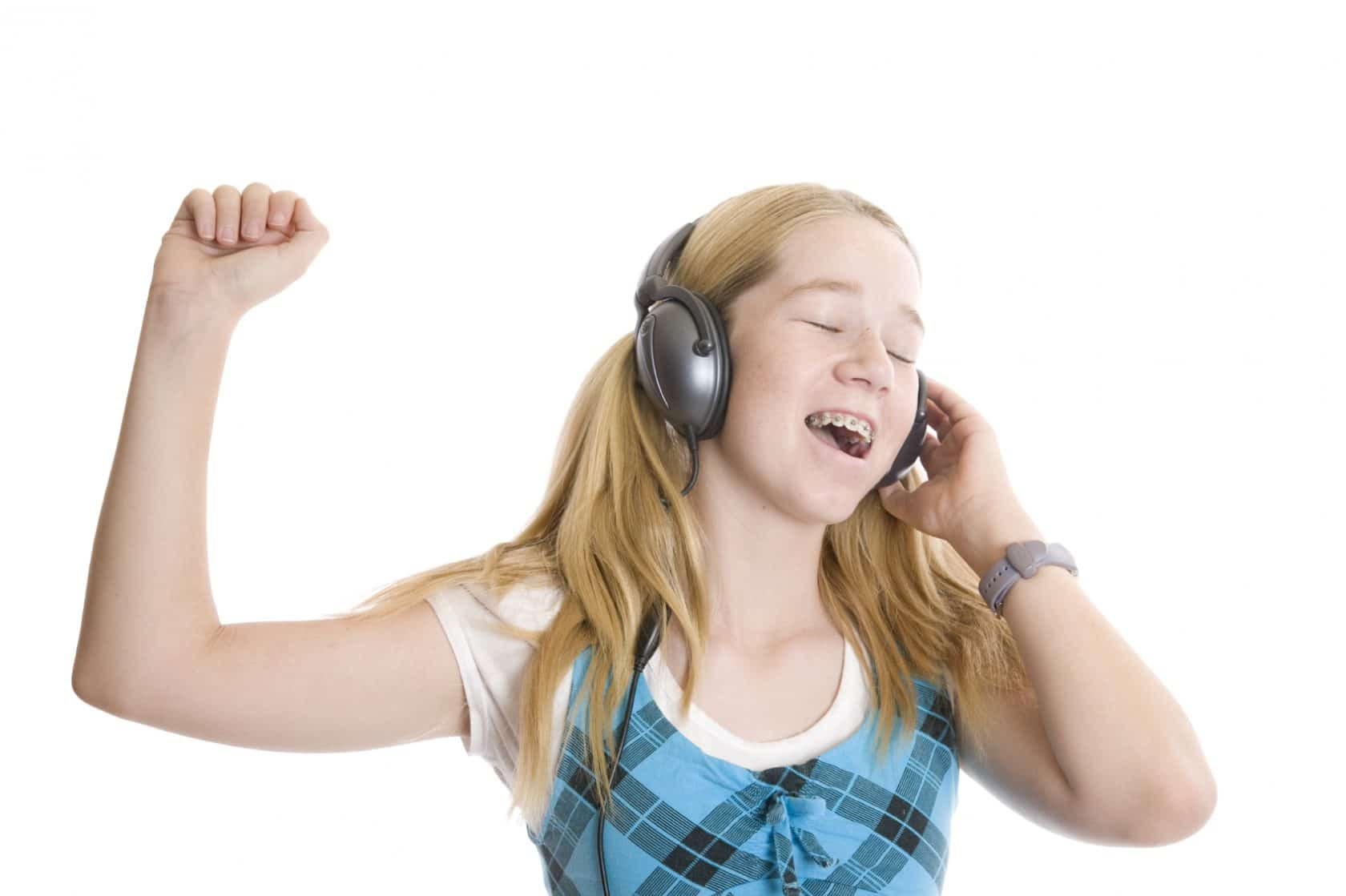 Girls with braces listening to music and singing
