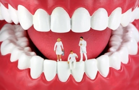 Doctors sitting on teeth