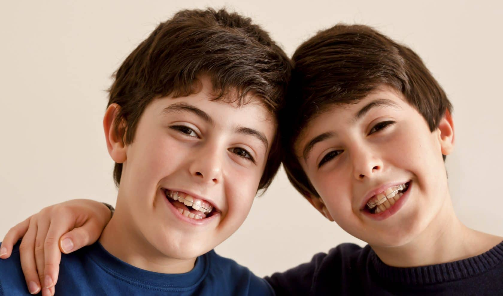 Photo of twins wearing braces