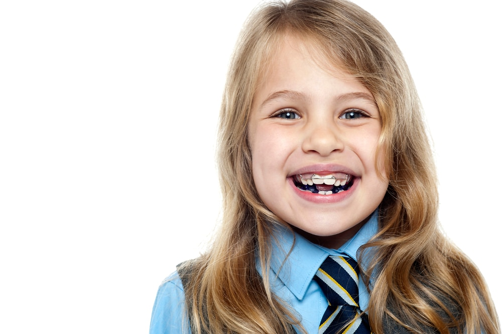 young school girl smiling with braces