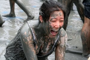 Girl with braces in Tough Mudder race