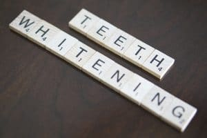 teeth whitening written in scrabble tiles